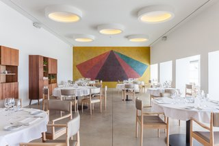 Vertical Gardens Spruce Up a Dusty Monument - Photo 5 of 6 - In the dining room, a mural by Sol LeWitt, painted in 1990, was uncovered. A circular theme, introduced in the original project, is reinforced by round lamps throughout the interior.