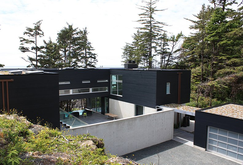 The main building sinks then elevates in full view of ocean. Tagged: Exterior, Prefab Building Type, and House.  Prefab by Joshua De La Paz from A Giant, 20-Module Prefab Perched Across a Coastal Site in British Columbia