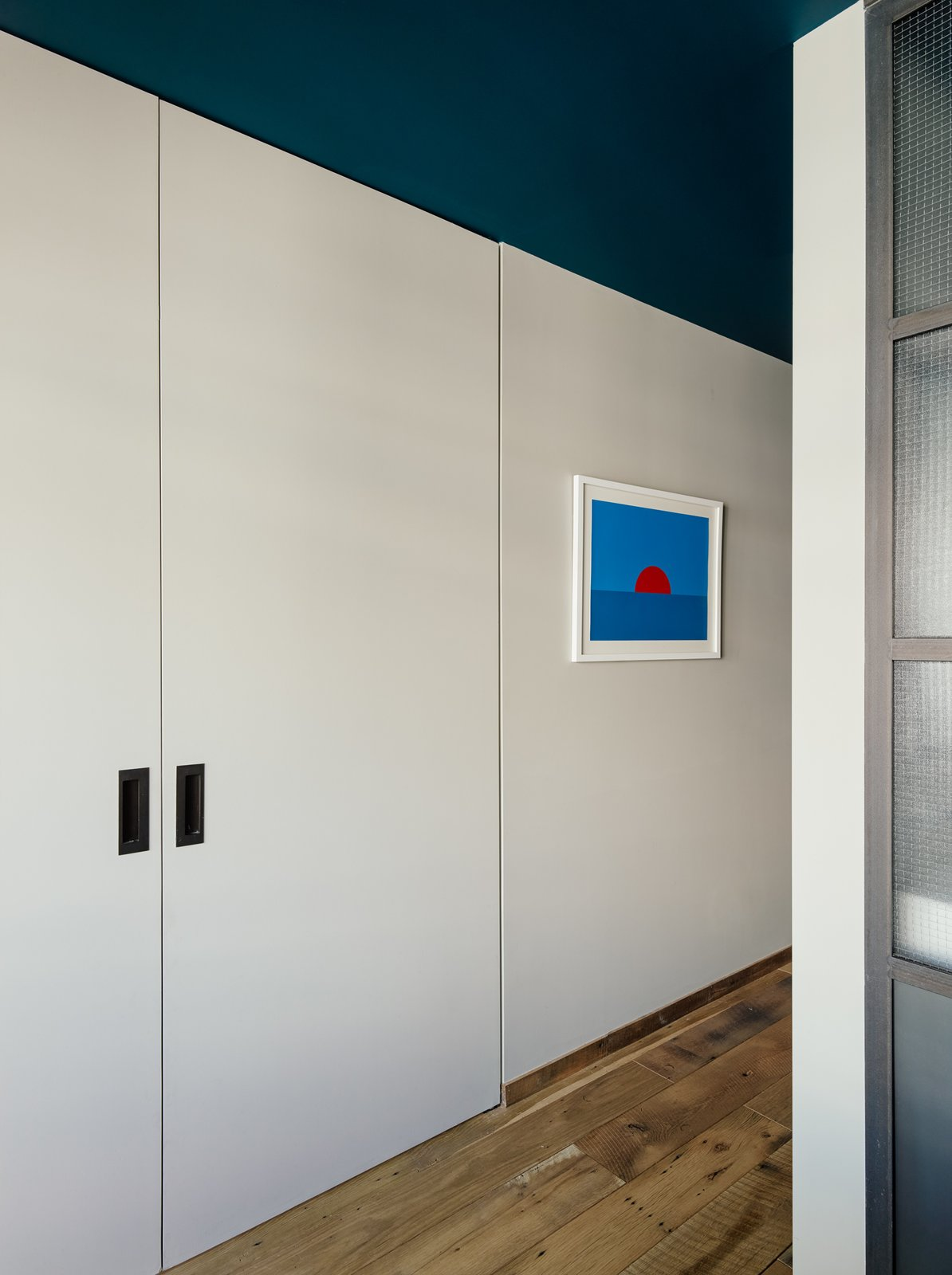 "The custom sliding doors are Zames's favorite detail in the home. ""They are functional, but also manage to balance nice clean modern details without being cold,"" she says."