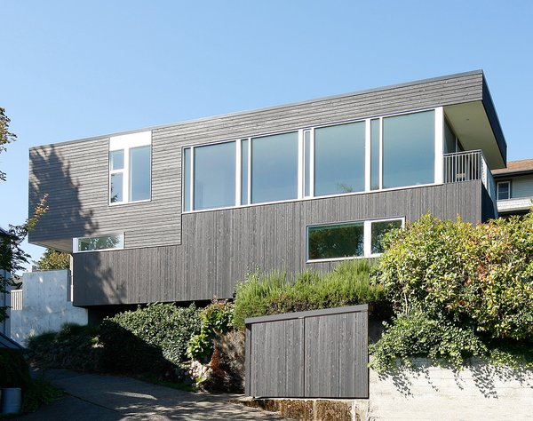 """Through the thoughtful consideration of how spaces are used, how they obtain natural light, how they obtain natural ventilation, and how they relate to the site, less materials were used in construction, and less energy is needed to live in the house,"" Hutchison says. Photo 9 of Portage Bay Bungalow modern home"