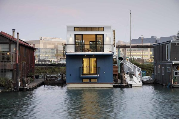 """""""By creating high ceilings with large windows, the feeling is all about space and light,"""" says architect Robert Nebolon, principal of Berkeley firm Robert Nebolon Architects. The 2,100-square-foot floating house was built on land in six months before settling into its final location in Mission Creek."""
