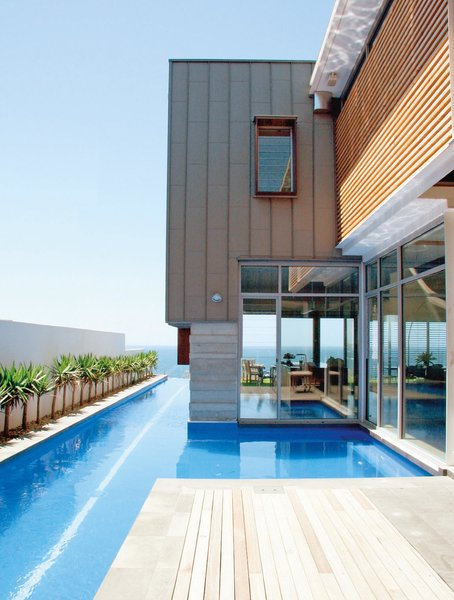 Wright Feldhusen Architects designed this house for a client that loves to swim. A lap pool connects the home to the ocean that lies beyond the property in Maroubra, Australia, a suburb of Sydney.