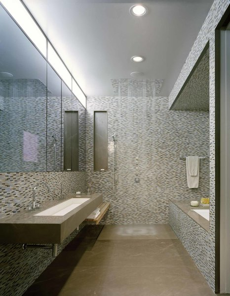 Wrapped in Anne Sacks tile, the master bathroom is outfitted with fixtures by Kohler.