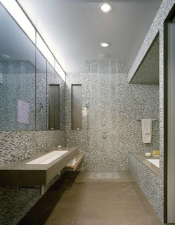 A Warm, Luxurious New York City Duplex With a Dramatic Catwalk - Photo 7 of 7 - Wrapped in Anne Sacks tile, the master bathroom is outfitted with fixtures by Kohler.
