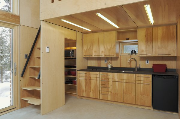 While there are two sleeping lofts—one above the kitchen, the other above the bathroom—the EDGE Cabin's multifunctional furniture can add a third bed.