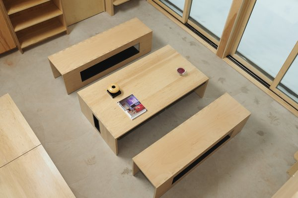 It quickly becomes a coffee table when its legs are folded inwards and hidden underneath the tabletop.