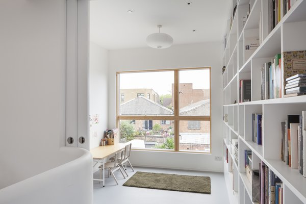 An office nook and library can participate in the open plan or disappear behind pocket doors.