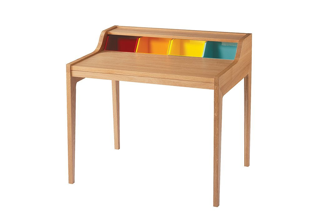 From the Remix line, an extendable oak desk based on the classic Davenport silhouette is updated with the addition of four colorful compartments.