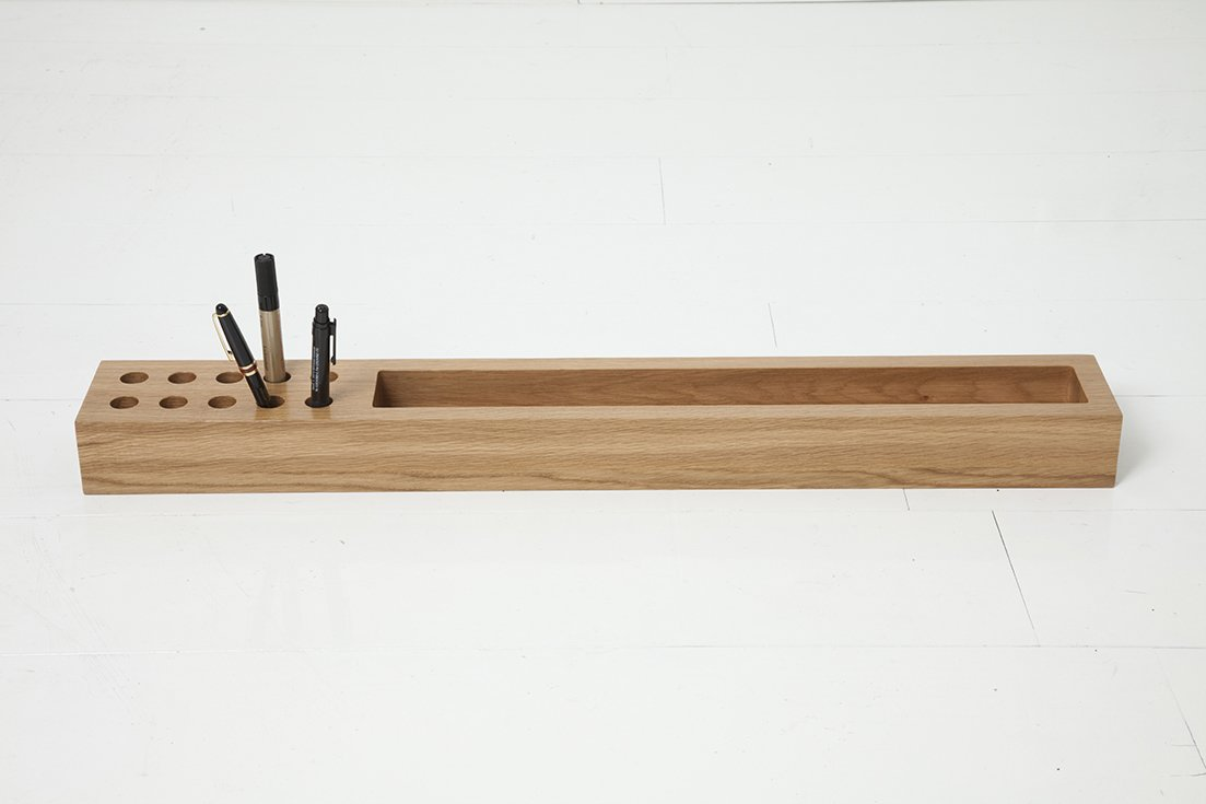 This simple desk organizer is carved out of solid oak. Tagged: Office.  Photo 10 of 14 in Modern Furniture Designer Continues Her Family Tradition