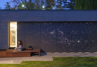 Guide to Understanding Laser, Plasma, and Water-Jet Cutting in Design - Photo 3 of 10 - Architect Janna Levitt laser cut an astral pattern into the garage door of this renovated Toronto home, installing LED lights behind the fiber-cement surface to complete her depiction of the constellations Sagittarius and Scorpio.