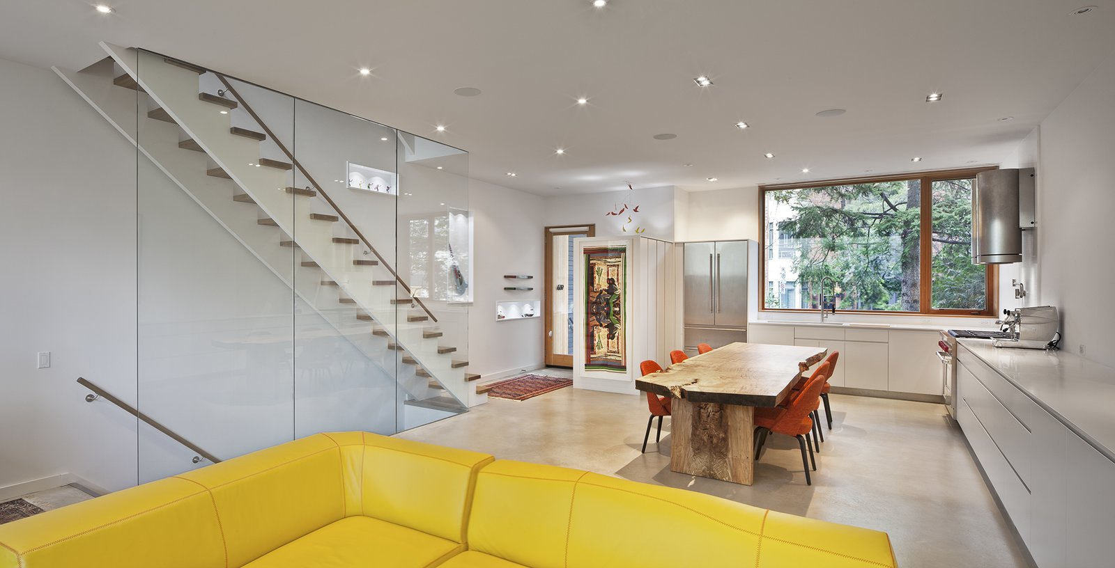 "Unlike the home's dark exterior, its bright interior ""incorporates large skylight elements, generous windows up to the ceiling, and an operable sliding glass wall facing the garden,"" Clarkson said. ROSS Windows & Doors allowed for the airy concept throughout the property.  King West by Kelly Dawson"
