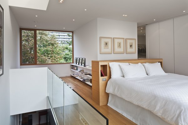 Benjamin Moore's Ultra White CC-10 was painted throughout the interior, including in the third floor's master bedroom. The house has five bedrooms, and two are used as personal offices. Photo 7 of King West modern home