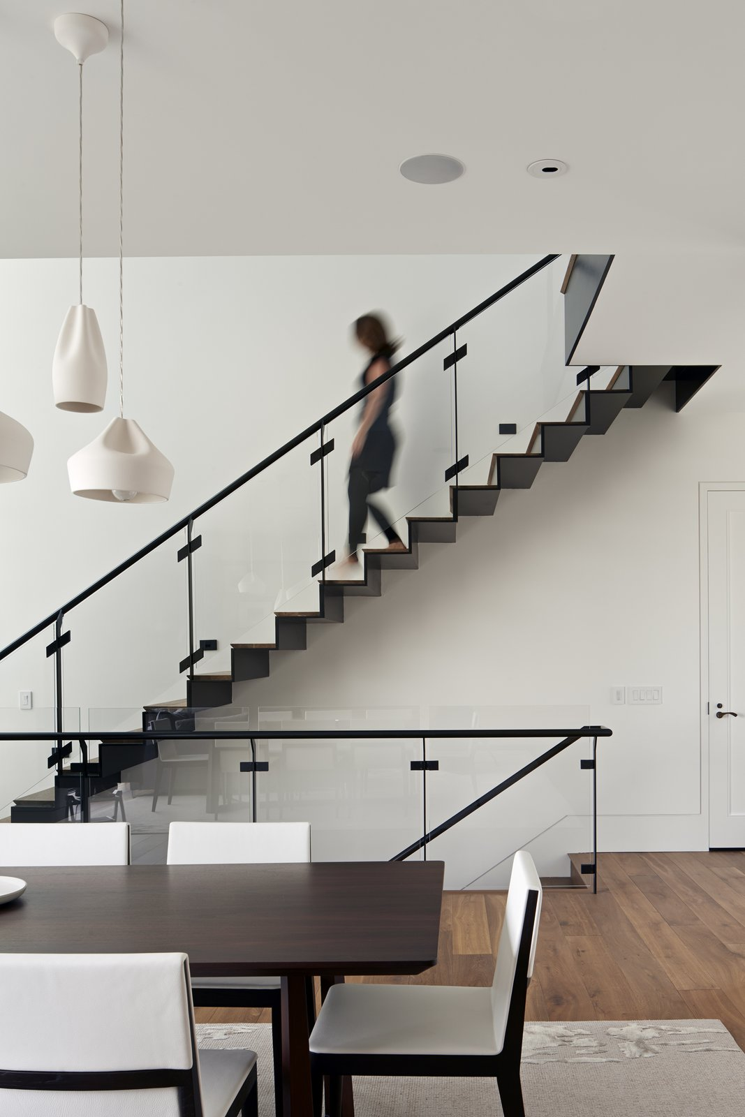 This staircase connects the common area to the guest suites above and the wine cellar below. The interplay of glass and metal on the handrails is a one of the architects' favorite details. Tagged: Staircase, Wood Tread, Metal Railing, and Glass Railing. 190+ Best Modern Staircase Ideas by Dwell