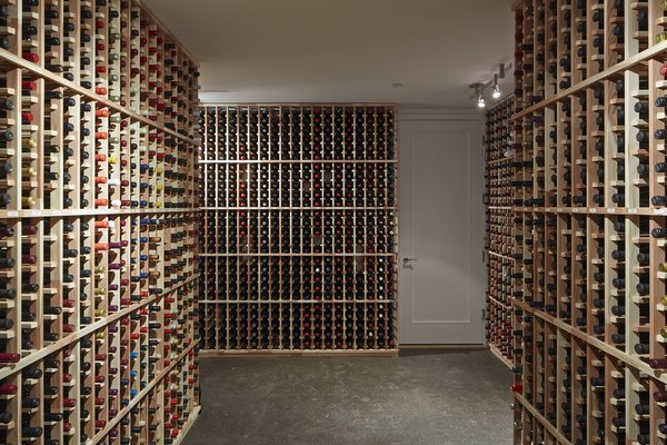 One of the biggest talking points of the home is its cork-floored wine cellar. Originally the garage, it was converted to accommodate the homeowner's sprawling collection. The thermal mass of the surrounding earth keeps the space cool. Photo 8 of Noe Residence modern home