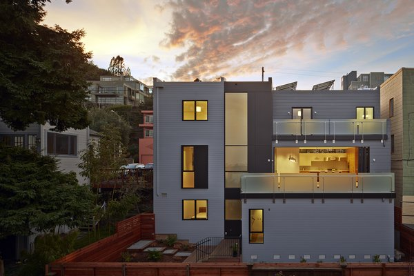 In contrast with the closed street-facing facade, the East-facing facade dramatically opens to expansive views of the Bay. Photo 9 of Noe Residence modern home