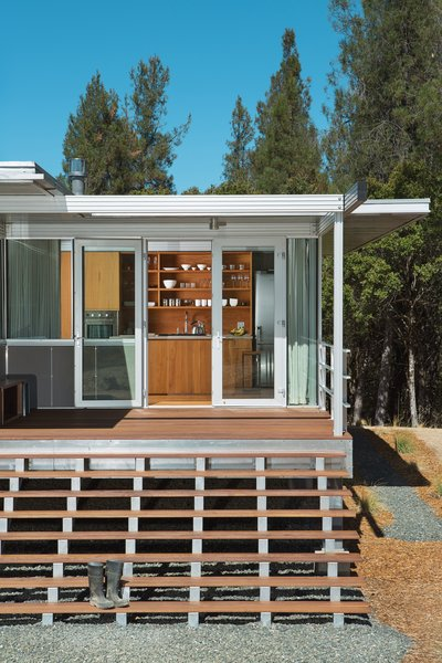 "A longtime fan of the Case Study houses of the late '50s and early '60s, Terry Ohm was attracted to the iT House, by Taalman Koch Architecture, for the design's ""transparency and minimalism."" His customized, smaller-scale version stands on a rural plot of land in Lake County, California. Ohm sits on his broad front steps often and appreciates their strong visual impact: ""The house is so little, you've gotta go for grand wherever you can get it!"" Photo 2 of Mayacamas Residence modern home"