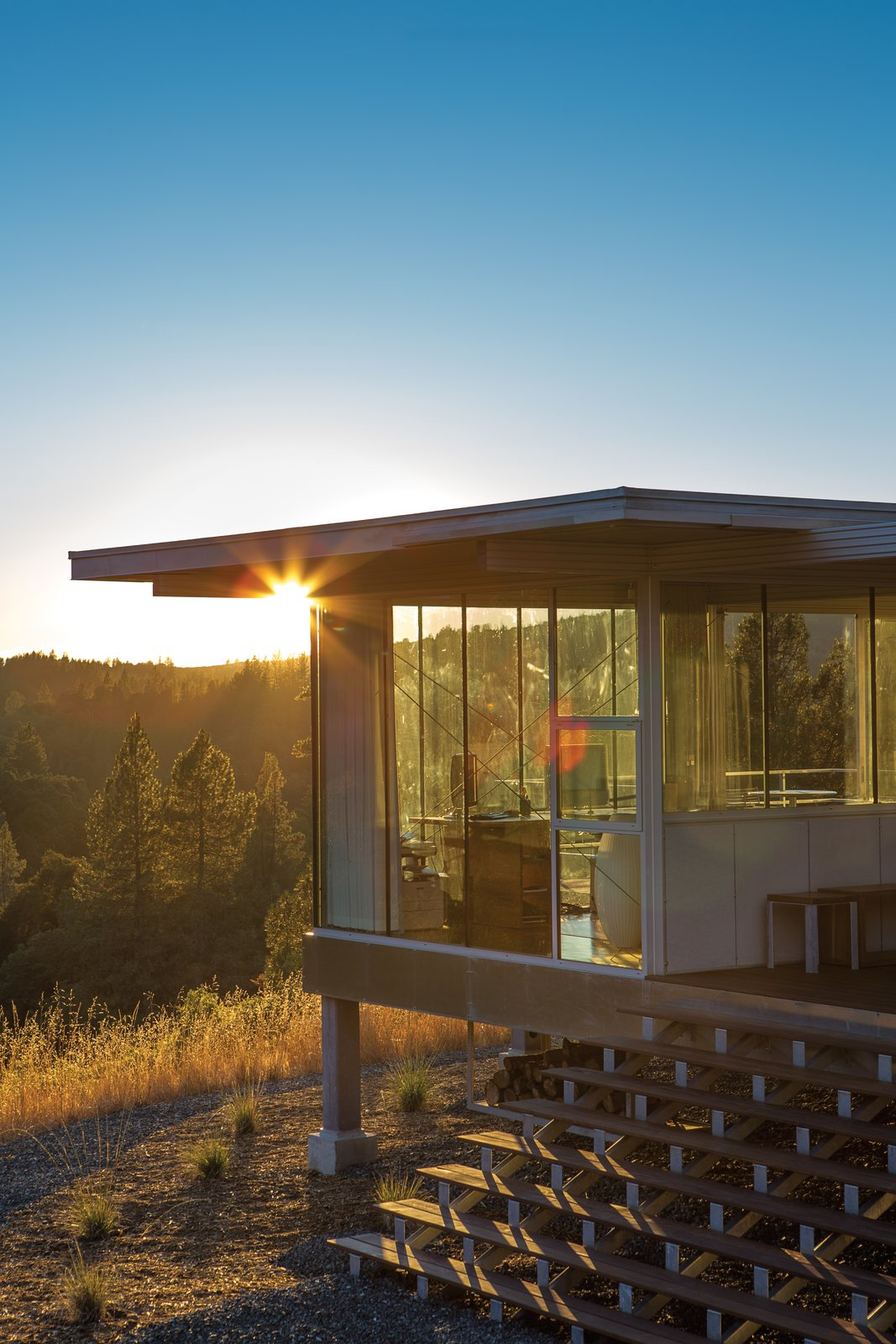 """I'm interested in designing things that are exactly what they need to be and nothing more."" —Architect Linda Taalman Tagged: Exterior, Metal Siding Material, Flat RoofLine, and Prefab Building Type.  16+ Prefab Homes in the Middle of Nowhere by Luke Hopping from Mayacamas Residence"