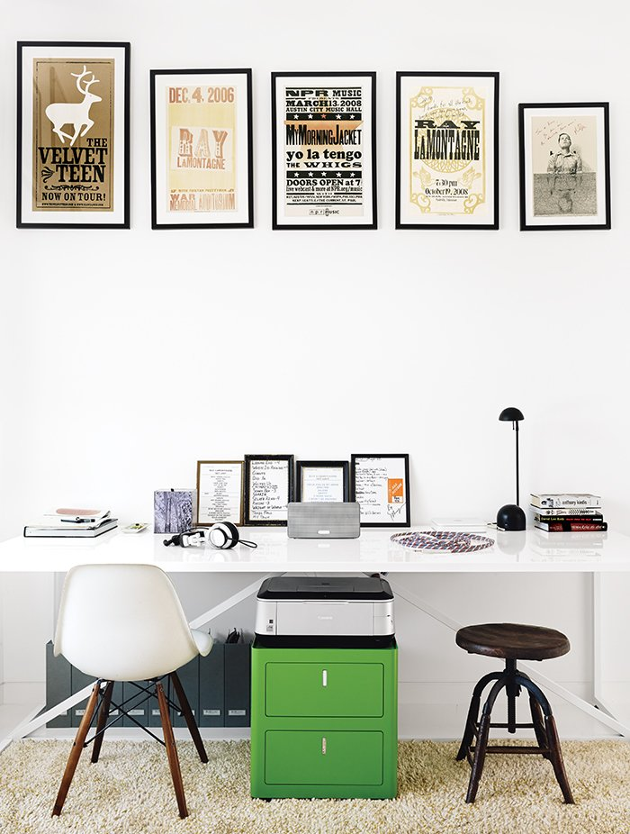 In the office, which is part of the addition, a collection of vintage posters hangs above a Cbox file cabinet and a table from Blu Dot used as a desk. The rug is a Photon. Tagged: Office and Desk.  Blu Dot Spotted by Blu Dot from 1920s Bungalow Plus Modern Addition Equals Perfect Austin Home