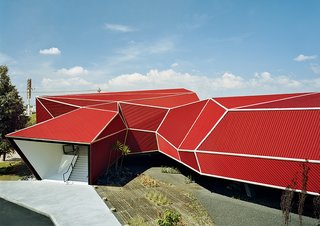The resulting building, its angular form inspired by Japanese origami—was designed and built in two and a half months in early 2007.
