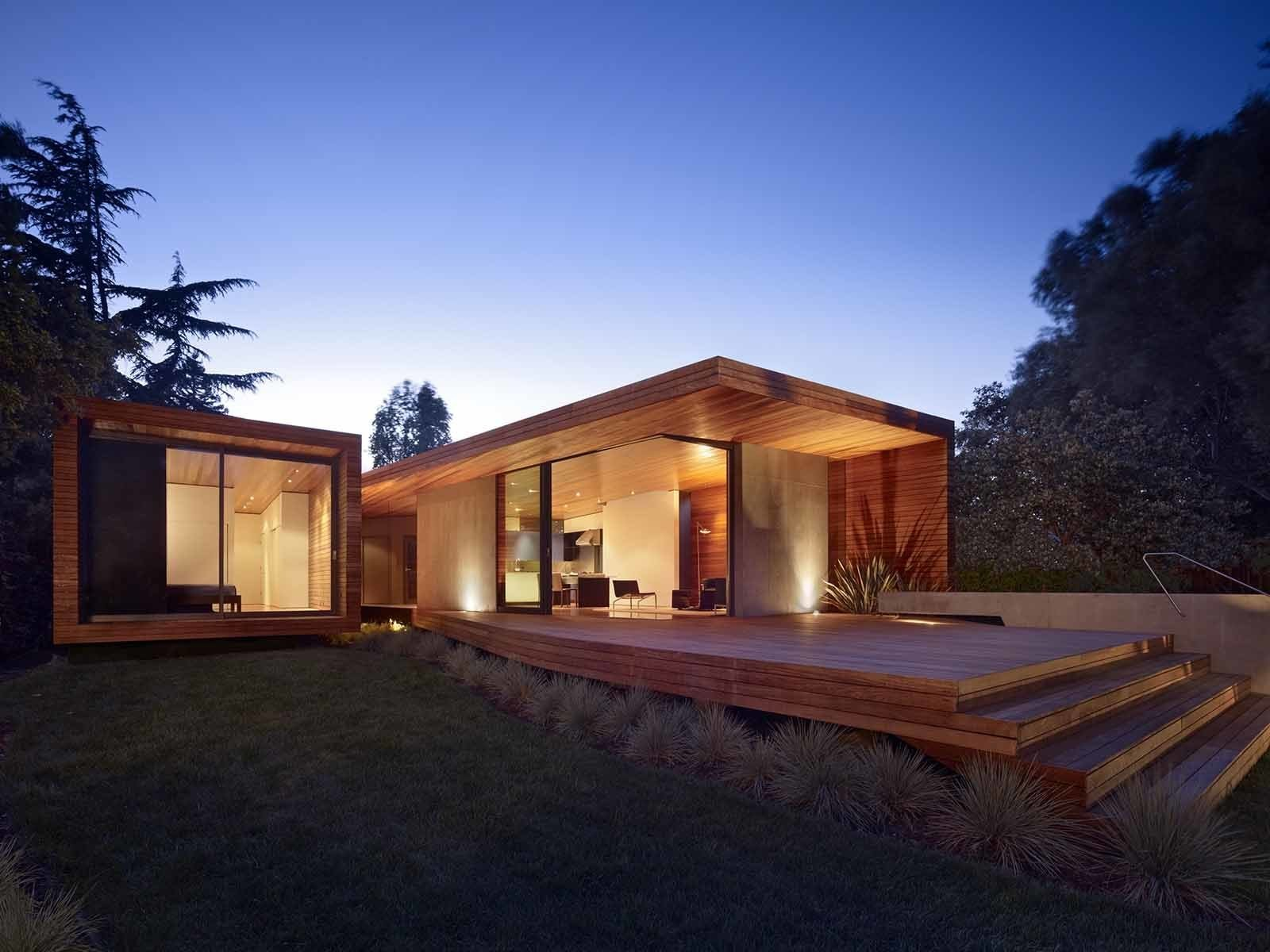 Open and inviting, the addition enables a fluid indoor-outdoor connection that didn't exist before. Tagged: Back Yard, Shrubs, Wood, Exterior, House, and Wood.  Best Exterior Wood Photos from 1950s Ranch