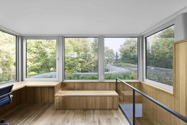 A small box atop the home looks out onto a green roof, designed by local landscaping firm Toits Vertige. Photo 7 of House of Lake Grenier modern home