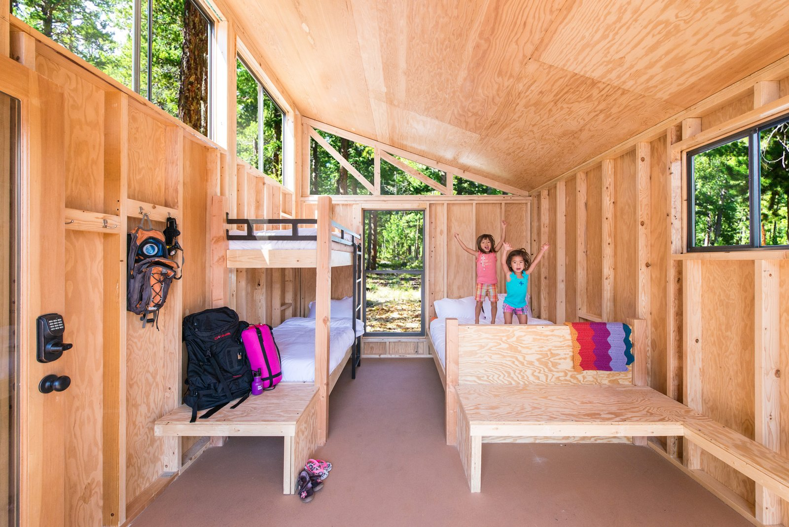 The structures were designed by Cal State Polytechnic University, Pomona, students. Tagged: Bedroom, Bunks, Bed, and Chair.  Photo 1 of 12 in 10 Prefabricated or Modular Structures That Use Plywood in Creative Ways from Modern Prefab Cabins for California State Parks