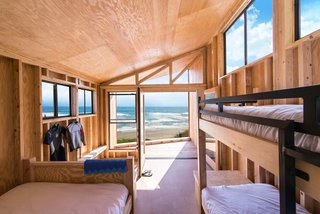 9 Modern Beach Bungalows - Photo 6 of 9 - Students were asked to balance issues of culture, sustainability, mobility, and construction in the design of a vacation cabin prototype for California's State Parks in which the prefabricated homes could be easily constructed and quickly relocated. The homes could be placed anywhere from an oceanside park to mountain ranges, and were designed with simple materials and construction techniques.