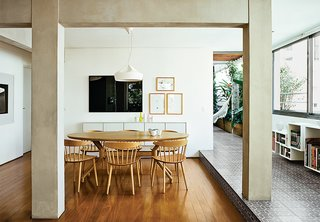 Modern Homes in Brazil - Photo 3 of 6 - Architects Simone Carneiro and Alexandre Skaff used materials like cement-tiles and perobinha wood to make a fomerly cramped São Paulo apartment feel more open. Re-envisioning an under-utilized terrace as a lush garden certainly helped as well.
