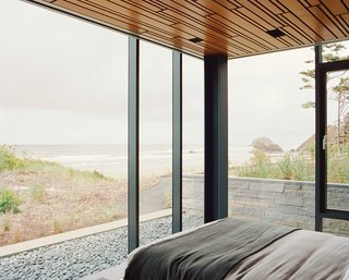 Glass House with Stunning Pacific Ocean Views - Photo 6 of 9 - The linens by Matteo Los Angeles in the master bedroom were among the fabrics that Mirjana Munetic of Boora selected for the Finleys. The idea was to find neutral tones that would not upstage the views.