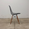 One of Aldana's Eames wire chairs.