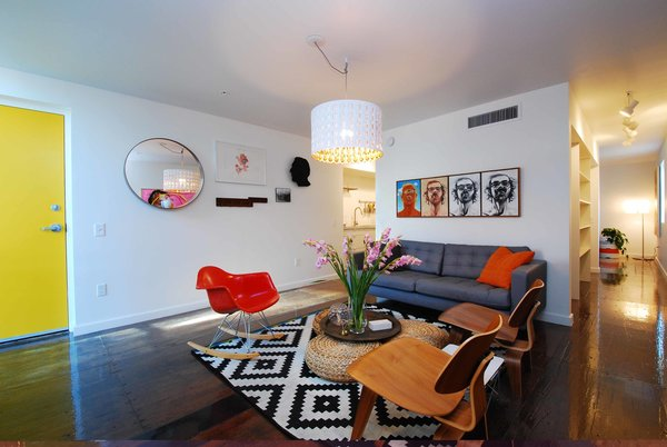 The lone furnished unit, which is slated to be an Airbnb rental, features a RAR rocker and two LCW chairs by Charles and Ray Eames.