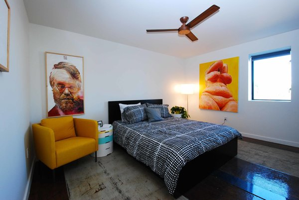 Nine-foot ceilings, white walls, and IKEA furniture define the bedroom, located at the back of the container.