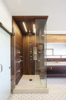 10 Best Modern Showers to Inspire Your Bathroom Renovation - Photo 10 of 10 - When Chris Brigham, founder of Knife & Saw, discovered water damage in the master bathroom of his San Francisco home, it turned out to be a blessing in disguise. The furniture maker and his wife had never loved the space, and Brigham took the opportunity to renovate with the help of designer/builder Fidel Archuleta of ArcSon Design. Lighting in the bathroom is provided by San Francisco-based Aion LED's modular fixture system. The linear lighting mimics the redwood siding.