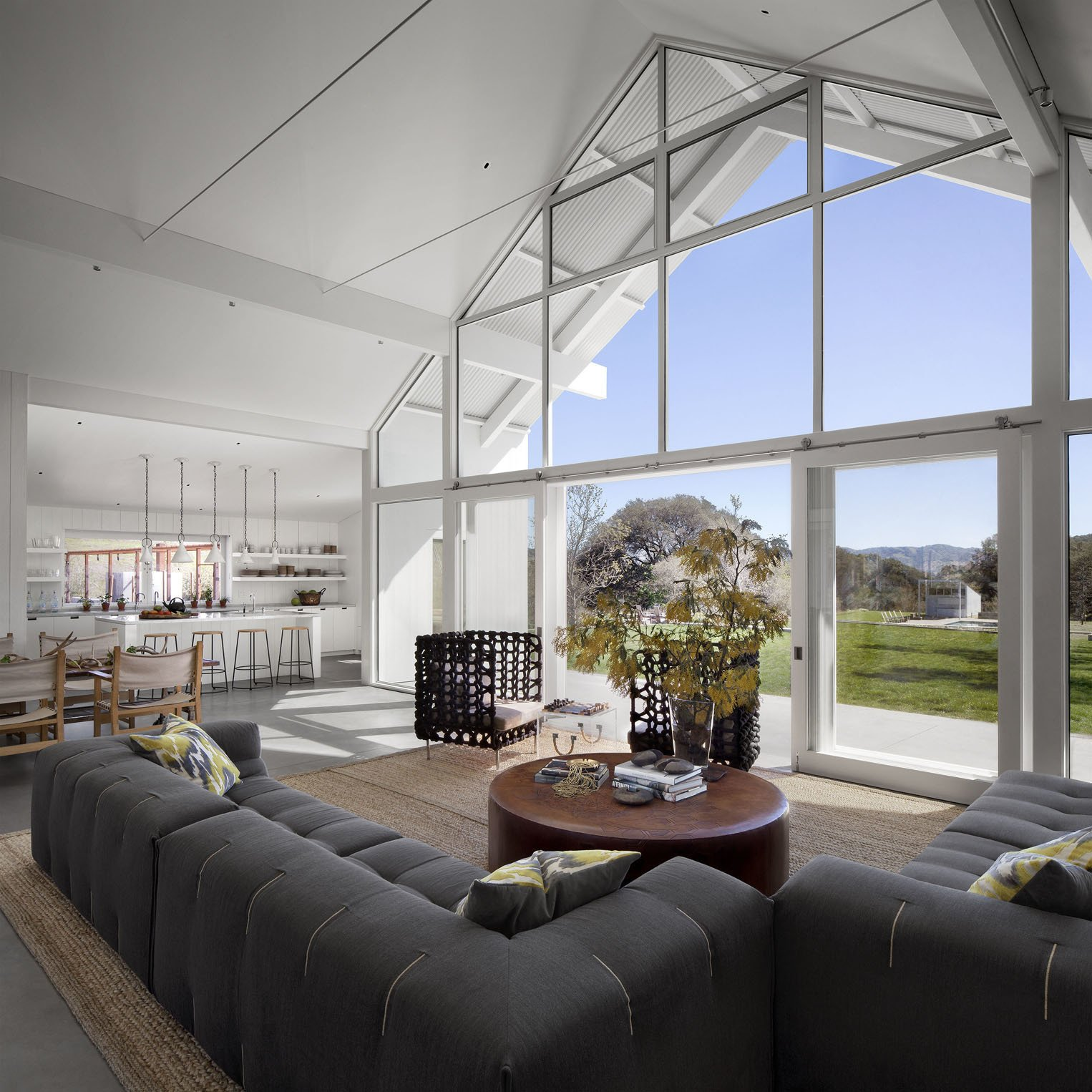 The dark Tufty-too sofas by Patricia Urquiola from B&B Italia contrast with the living room's abundance of light. A LEED Platinum Family Home Takes the Place of an Abandoned California Farmhouse  by Kelly Dawson
