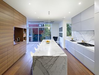 "Mad About Marble: 20 Kitchens and Bathrooms - Photo 2 of 20 - ""The walnut unit between the kitchen and dining room ties into the fumed oak floor,"" Dubbeldam says. ""The rest of the materials in the house—glass, marble, stone—were selected to offset the wood."""