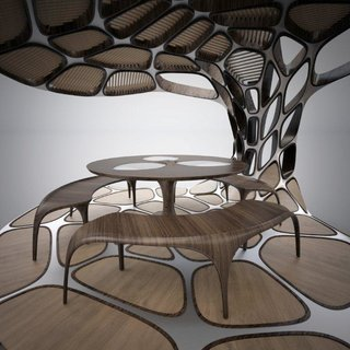 Why Your Next Prefab May Be by a World-Famous Designer - Photo 1 of 8 - Volu Dining Pavilion by Zaha Hadid and Patrik Schumacher One of the first unveiled designs features curvy wood dining furniture nestled inside a metal structure in the shape of an oversized open clamshell. Backlit by purple-toned LEDs, Volu embodies the sci-fi effect typical of Hadid's work. Each Volu Dining Pavilion, to be be produced in an edition of 24, will go for $480,000.