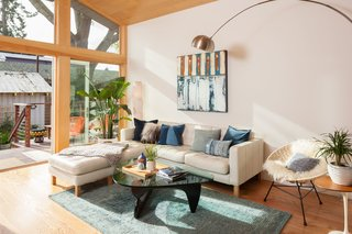 Renovation: A Sunny Berkeley Bungalow Invites the Outdoors In - Photo 2 of 5 - The sofa is a Karlstad sectional from Ikea. The 1,400-square-foot home contains a master bedroom and two guest rooms.
