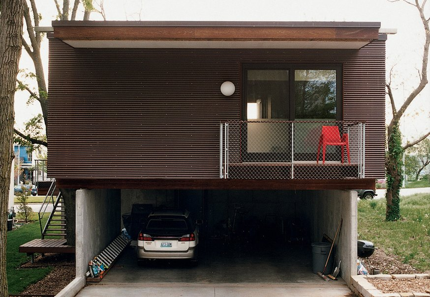 "Architect Jamie Darnell had a simple plan for his family's home in Kansas City, Missouri, but the result is anything but plain. Wrapped in corrugated copper, the house has a frontier-cabin quality that's evolving with age. At first it was as shiny as a penny, but that's changing. ""My house looks like it has a skin disease,"" Jamie says. ""It's just oxidizing in a weird way. Eventually it'll go green. This is just the first stage of the patina.""  Minimalist Facades We Love by Zachary Edelson"
