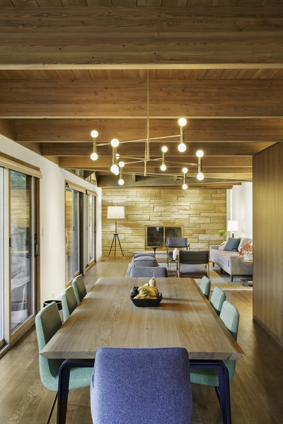 """The new floor plan is considerably more open than the original plan, and the interior and exterior details have been simplified and made consistent,"" Schultz said. A Lambert & Fils light fixture illuminates a dining set by Ligne Roset. Photo 4 of City Skyline modern home"