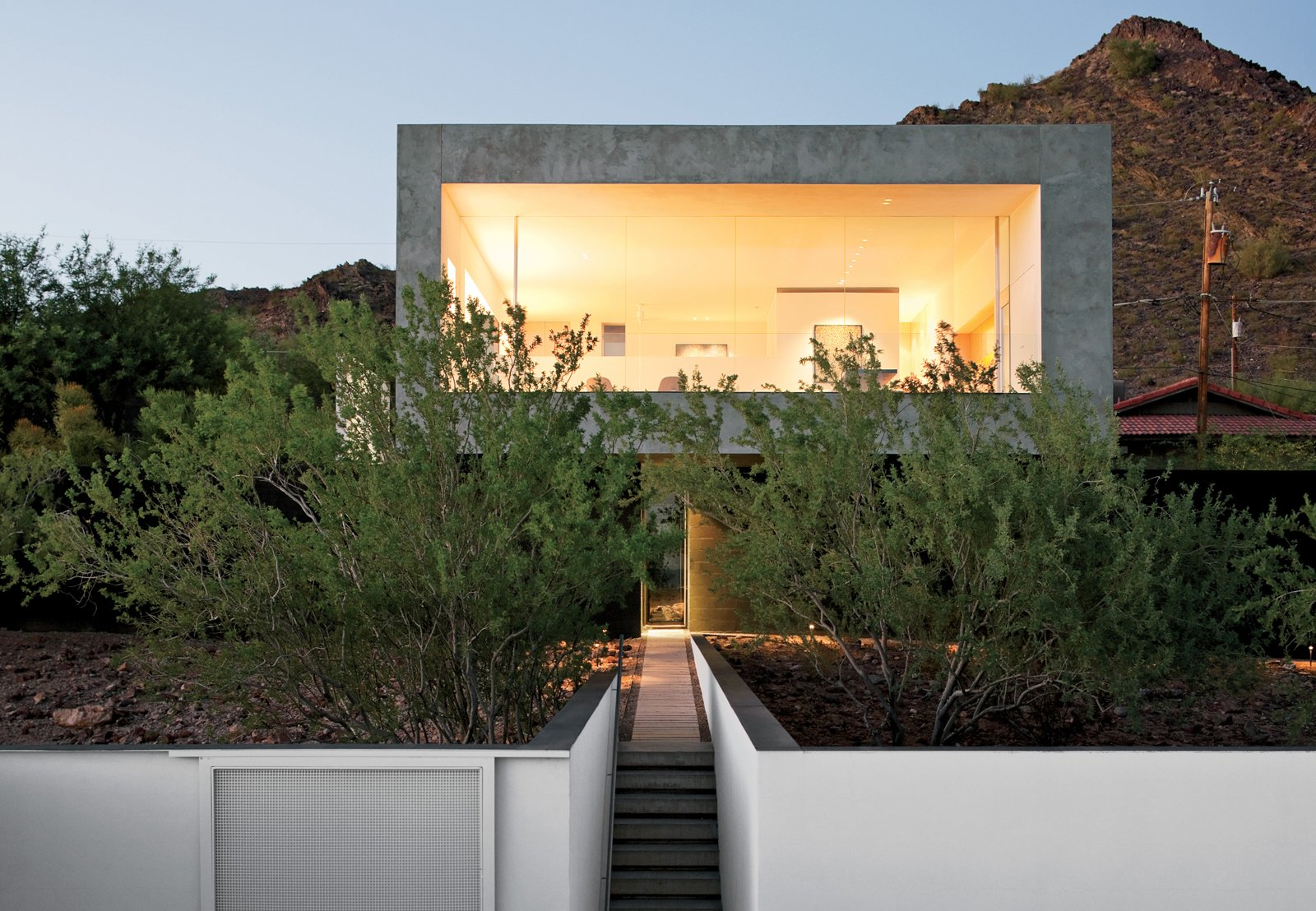 At the base of Echo Mountain in Phoenix, a geometric home by Wendell Burnette opens up to the surrounding desert landscape.  Desert Homes by Heather Corcoran