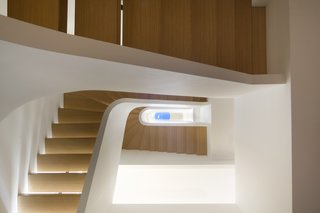11 Modern Stairways That Do Way More Than Just Connect Floors - Photo 4 of 11 - Space4Architects created a serene and fluid space on the Upper West Side. Shown here is the Piranesian view that looks upwards through the central stair to the top floor skylight.