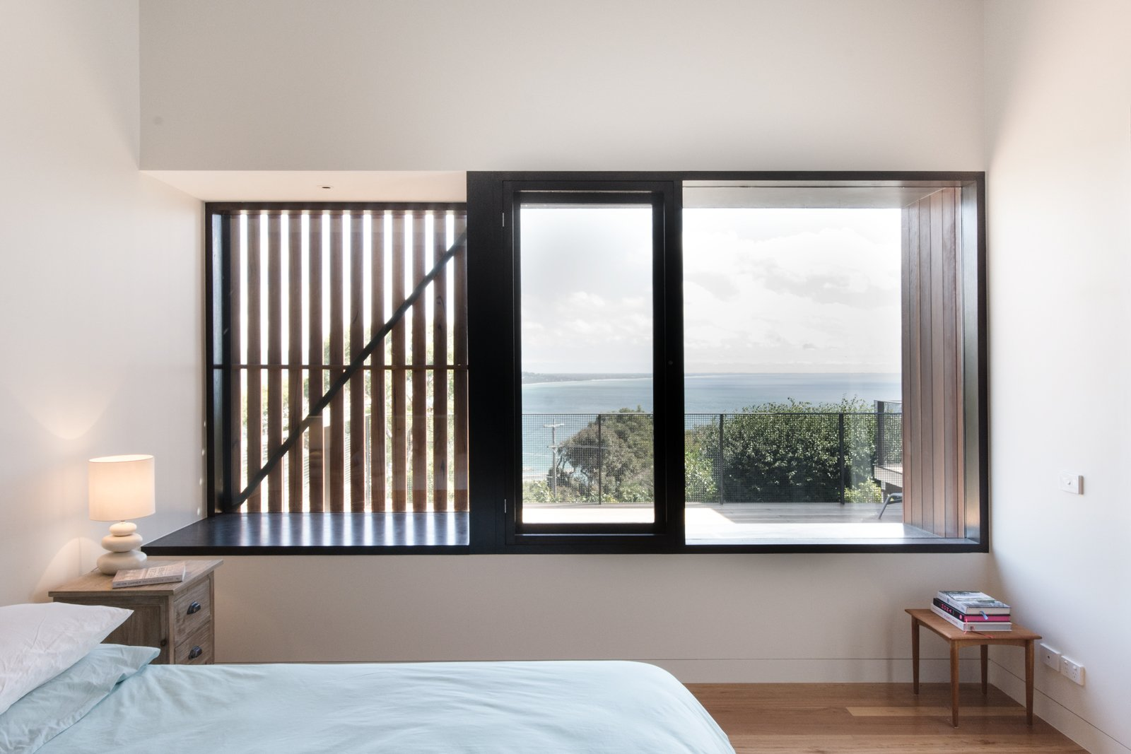 "External shutters and screens allow the homeowners to manage the sunlight and cross ventilation in certain rooms. Manos Mavridis, also of OLA Studio, explains, ""There was a preference for the screens to be manually operated to minimize ongoing maintenance costs and encourage user engagement with their environment.""  Photo 8 of 8 in An Australian Beach Home with Stunning Ocean Views from Martha"