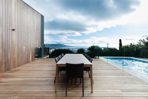 A Mood Outdoor Table by Studio Segers for Tribù is surrounded by Terra Outdoor Chairs by Bram Bollen, also for Tribù. They rest atop silvertop ash hardwood decking. Photo 8 of Martha modern home