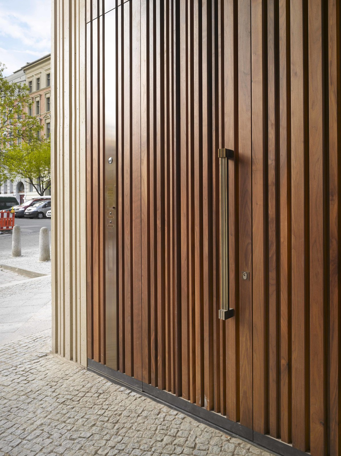 The wooden door mimics the structure's textured exterior.  Photo 10 of 10 in Take a Peek Through These 10 Modern Front Doors from Stunning Architectural Drawing Museum in Berlin