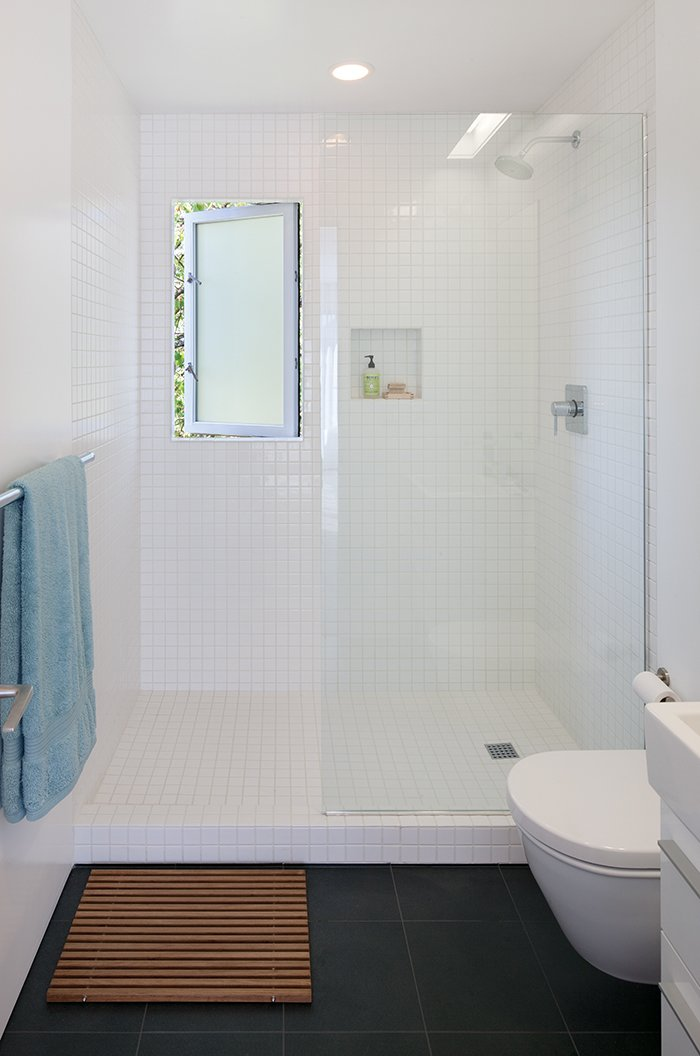 The master bathroom is clad in inexpensive tile from Daltile. The wall-hung toilet is by Duravit. Tagged: Bath Room and Tile Counter. An Industrial Designer's House Blends Economy and Simplicity - Photo 7 of 9