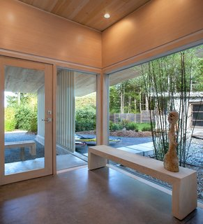 A Couple's Cherished Vacation Home is Given a Second Life - Photo 3 of 9 - Polished concrete with radiant heating comprise the cabin's interior floors, and its ceilings are made of Douglas fir. Jones designed the custom windows, which were fabricated by contractor Ian Maclean.