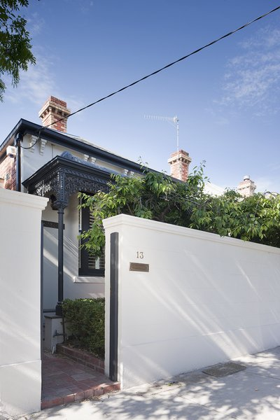 As a nod to local history, the designers kept the home's original street-facing Victorian facade. Photo  of Seclusion modern home