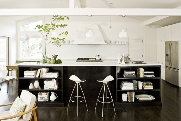 The firm opened up the closed off kitchen, orienting it in the center of the living space.