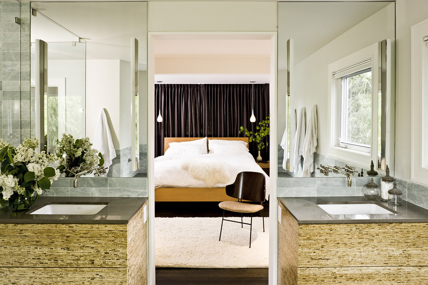 The cabinets in the master bathroom are made of kirei board, a material produced from the stalks of sorghum. Tagged: Bath Room, Undermount Sink, Dark Hardwood Floor, and Pendant Lighting.  Photo 4 of 5 in A Designer's Tips For Renovating a Midcentury Modern Interior