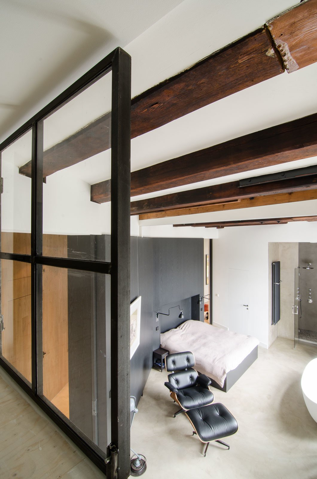 "The original beams, as seen from the loft, offer a warm and textural contrast to the sleek and modern finishes introduced during the renovation. ""There's a lot of nice patina to the very old beams; we definitely wanted to show that,"" says van Hulzen."
